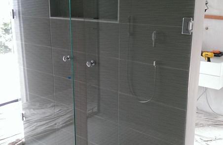 Fold away shower screen
