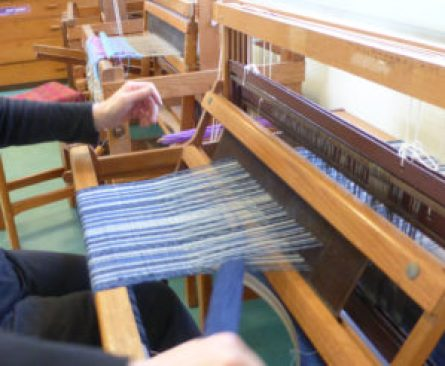 Loom warped for vest fabric. It is being woven in plain weave.