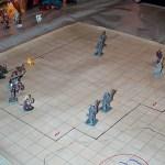 A angled shot of hero figurines battling villains.
