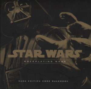 Darth Vader reaches out from the cover of the Saga Edition rulebook.