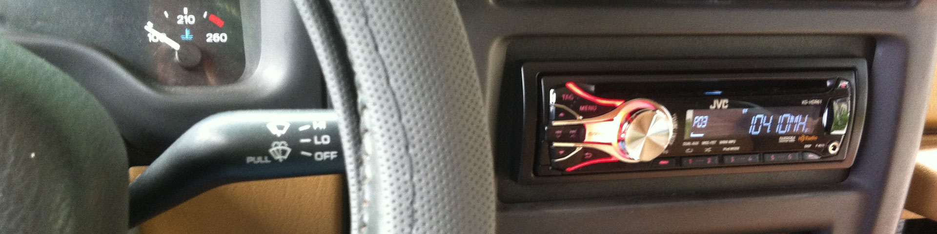 A close-up shot of the jeep's steering wheel and new digital radio.