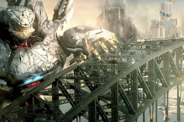A bridge stands between a giant robot and his giant monster opponent.