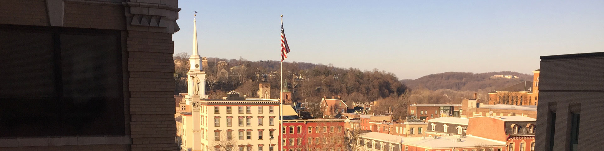 A view of the cityscape of Easton. A blue sky appears overhead.