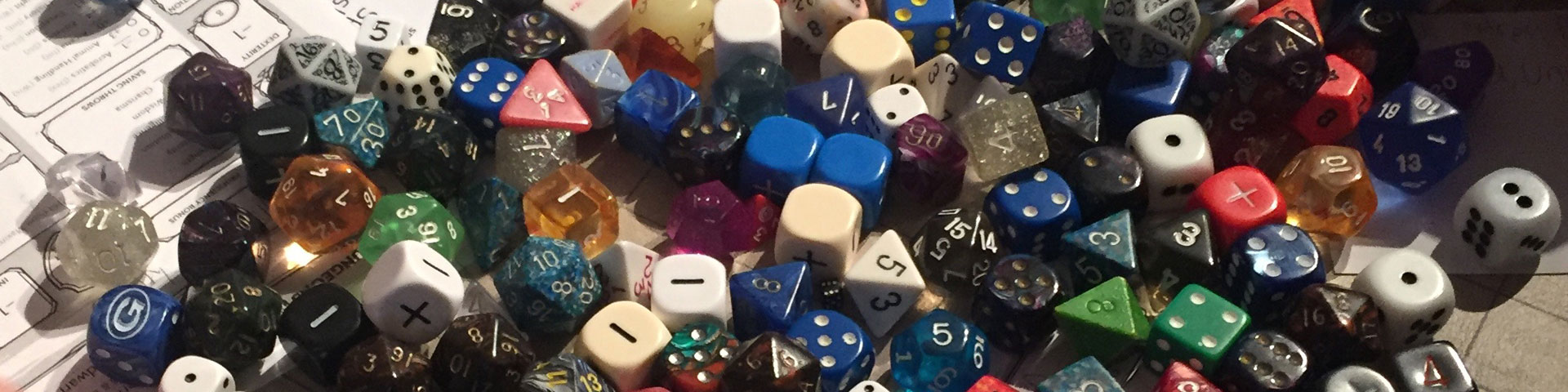 A close-up view of various polyhedral dice.