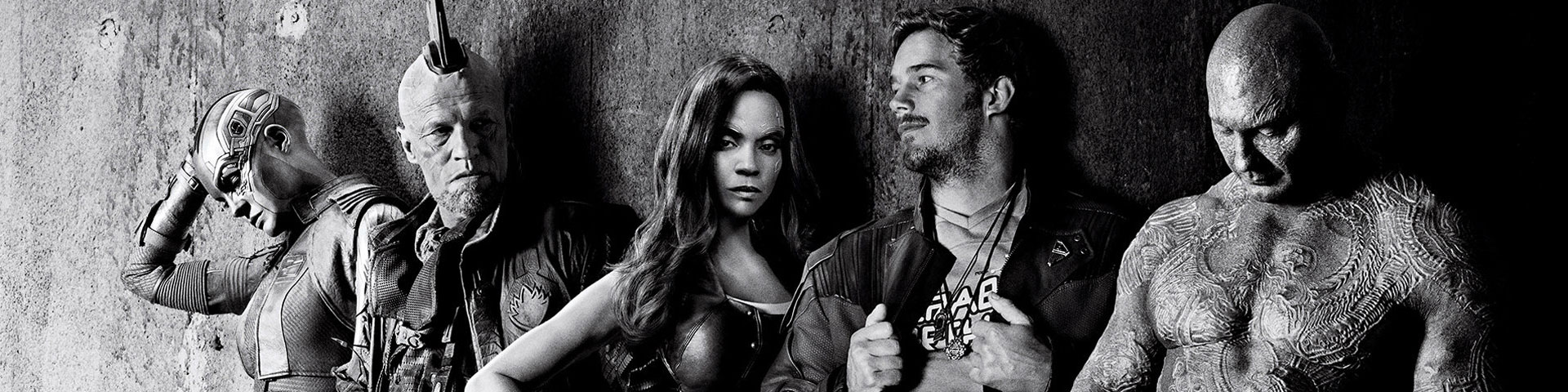A black and white photo of the Guardians of the Galaxy standing against a wall.