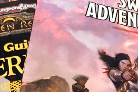 A close up of several Waterdeep-centric role-playing game books.
