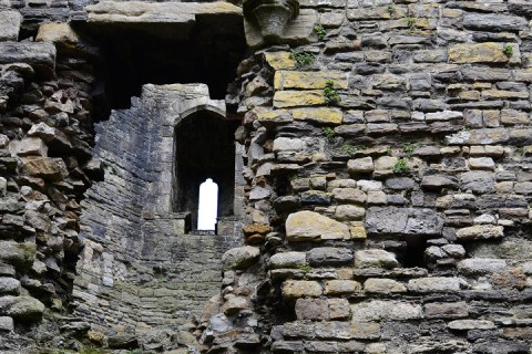 A series of stone walls, with archways leading onward.