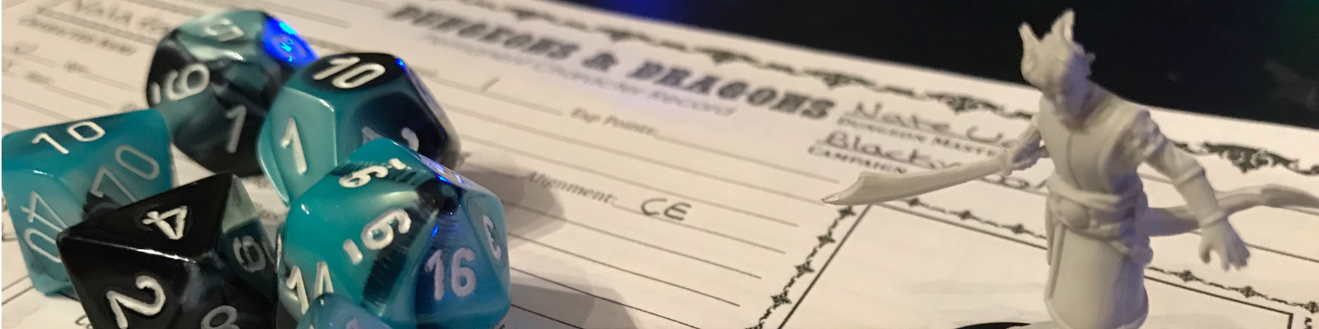 A close up view of blue/black dice and a tiefling warlock. In the background is an old-school style character sheet.