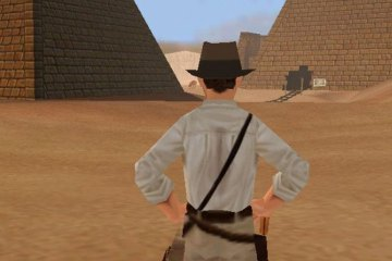 A digital rendering of indiana jones stands with his back to the viewer, surveying some pyramids in the desert.