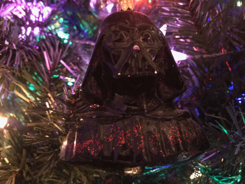 A black Darth Vader bust hands in a Christmas tree