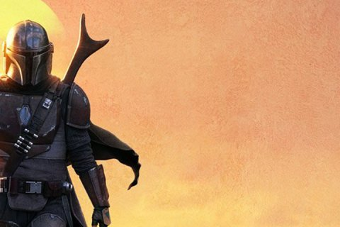 An armored warrior walks out of a sunset.