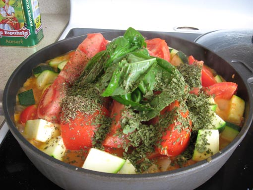 In go the tomatoes, courgettes, and herbs.