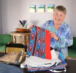 SEW GOOD: Gayle with some of the fabric bags in her Gordonton home.