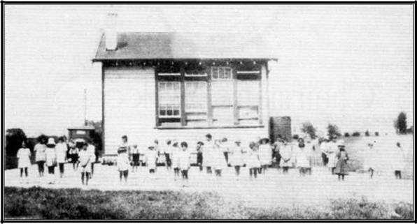 A photo from the 1920s showing the students enjoying time outside.