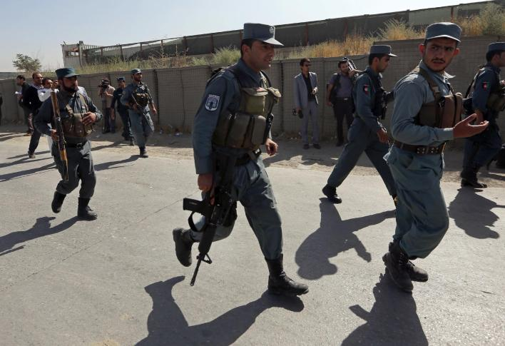 """Afghan Security police run at the site of a truck bombing, in Kabul, Afghanistan, Monday, Aug. 1, 2016. Afghan authorities say an overnight attack on a guesthouse for foreign contractors claimed by the Taliban has killed at least one policeman and wounded several others. The Interior Ministry says """"terrorists"""" used a truck full of explosives to breach the wall of the hotel around 1:30 a.m., then three gunmen entered the premises and started shooting. (AP Photos/Rahmat Gul)"""