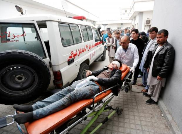 An injured man is transported to a hospital after a suicide attack in Kabul, Afghanistan November 21, 2016. REUTERS/Mohammad Ismail