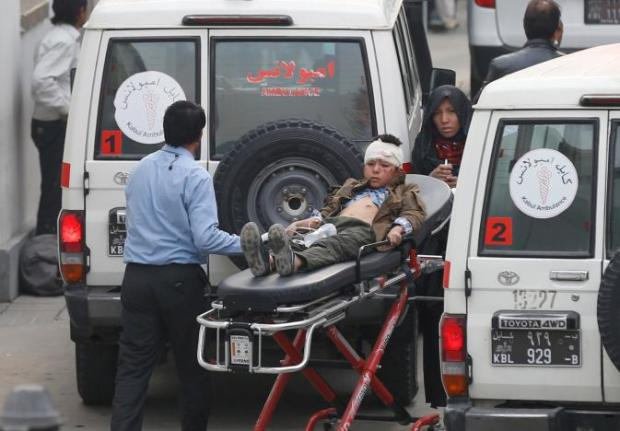An injured boy is transported to a hospital after a suicide attack in Kabul, Afghanistan November 21, 2016. REUTERS/Mohammad Ismail