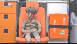 a-syrian-boy-after-an-airstrike-at-aleppo-white-hair-from-dust
