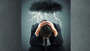 man with storm cloud over head, difficulty