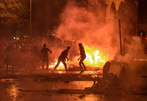 people protesting, fire burning,adobe-of-satan