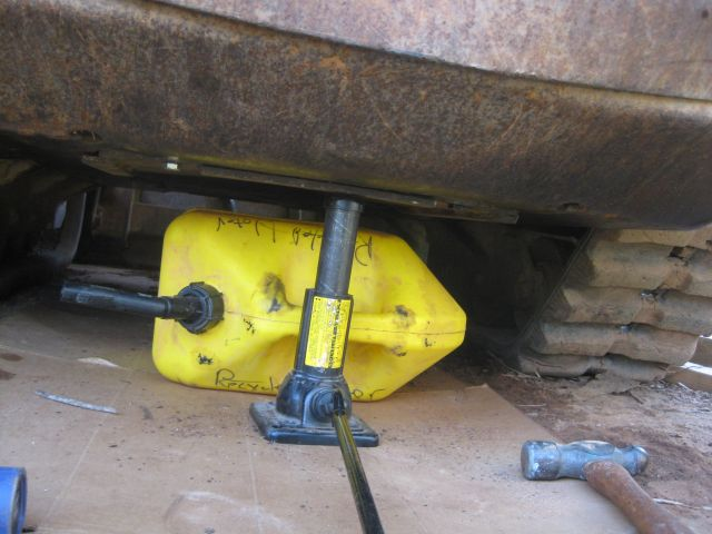 the yellow plastic container was to hold the access plate in place while I made the adjustments. the jack was invaluable