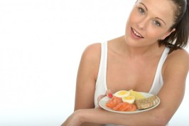 Healthy Happy Attractive Young Woman Holding a Typical Norwegian or Scandinavian Breakfast