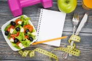 Workout and fitness dieting copy space diary on wooden table.