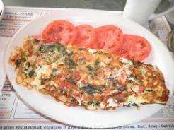 garden omelet withsliced tomatoes