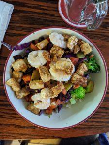 bowl of stir fry with tofu, shrimp and veggies
