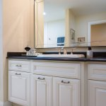 White Cabinets And Black Granite Countertops In A Bathroom Nuwood Cabinets