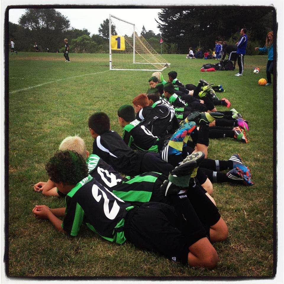 boys soccer sideline pose