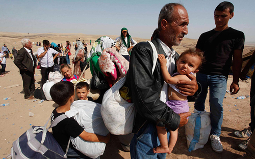 https://i1.wp.com/www.nwasianweekly.com/wp-content/uploads/2015/34_49/com_refugee.jpg?resize=500%2C313