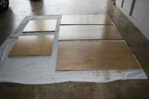 Marine ply cut to size receiving last coat of low VOC polyurethane clear finish.