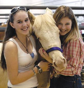 Lindsay Scherer and Jamie Rinehart with Linday's 7-month-old mustang foal