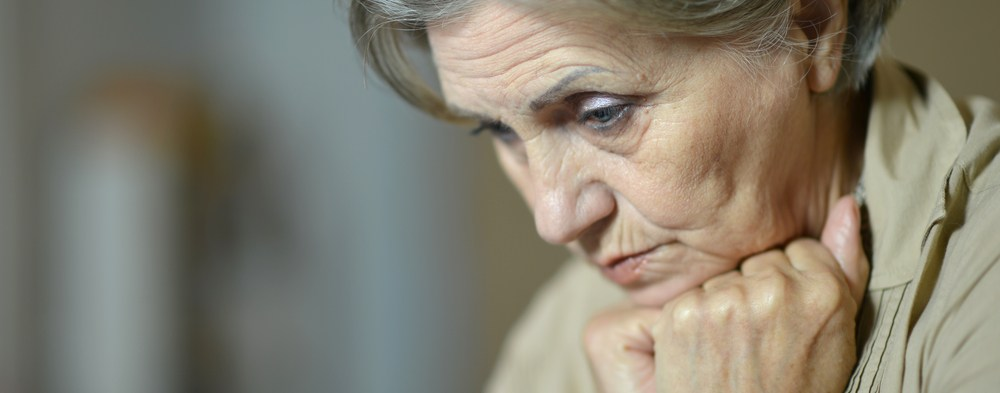 aging woman resting head on fists