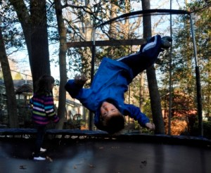 boys playing trampoline