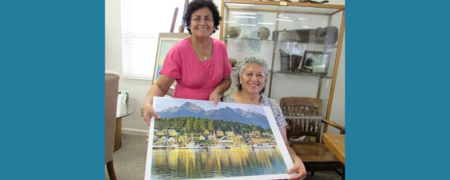 Two library patrons with finished Puzzle