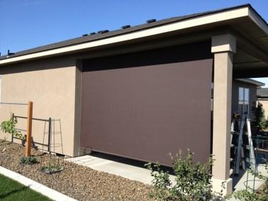 Dark Bronze Shade On Stucco Home