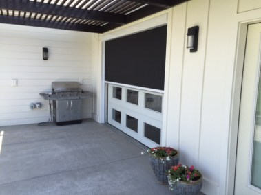 Motorized Black Shade on Garage Door