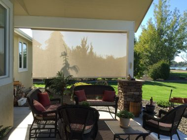 Cable Guided Stucco Solar Shade from inside patio