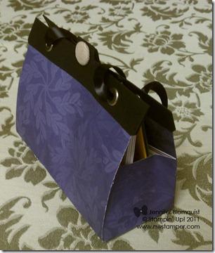 hostess luxury purse side view