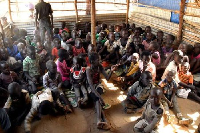 Children sit on the floor inside a classroom in Konyokonyo camp for the internally displaced people(Photo: file)