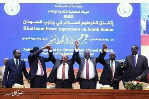 Leaders of South Sudan's warring parties shake hands during peace talks in Khartoum, Sudan, July 2018(Photo: supplied/file.Nyamilepedia)