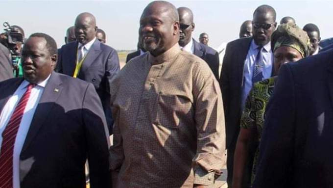 Machar (R) and as he arrives at Juba International Airport (File/Supplied/Nyamilepedia)