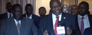 South Sudan's Machar (C) flanked by members of teh pre-transitional committee talking to the press in Khartoum on Tuesday, 23rd October 2018 (File/Supplied/Nyamilepedia)