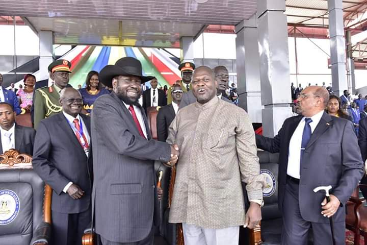 South Sudan President, Salva Kiir Mayardiit (L) shakes hands with SPLM-IO leader Dr. Riek Machar Teny-Dhurgon during peace celebrations at Dr. John Garang deMabior Mosoleum in Juba (File/Supplied/Nyamilepedia)
