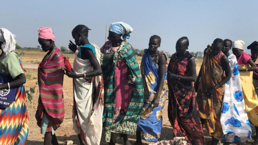 Women line up for food rations at a distribution site in Bentiu, South Sudan, on December 8, 2018. © 2018 Nyagoah Tut Pur/Human Rights Watch