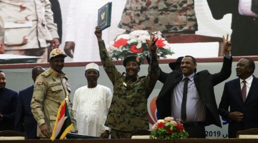 Chairman of Sudan's TMC al-Burhan as he signs agreement with protest organizers in Khartoum on Saturday (File/Supplied/Nyamilepedia)