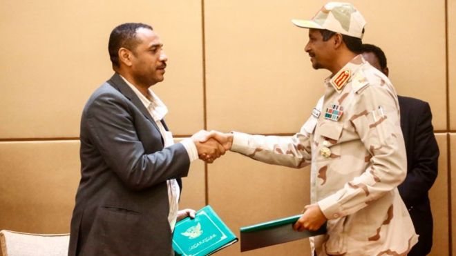 Gen Mohamed Hamdan Daglo (R), Sudan's deputy head of the Transitional Military Council, and protest leader Ahmed Rabie shake hands after signing the constitutional declaration(Photo credit: supplied)