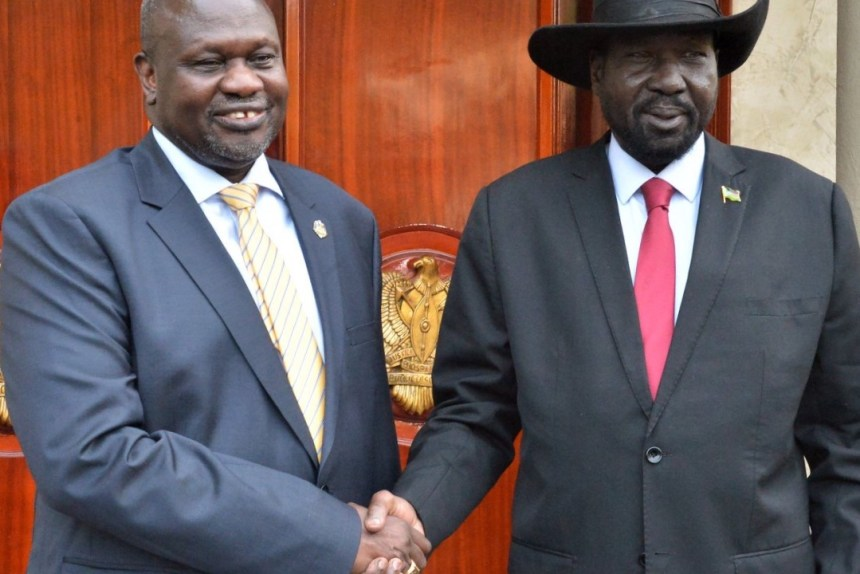 South Sudan president Salva Kiir Mayardit, right, and SPLM-IO leader Dr. Riek Machar, left, shaking hand following a face-to-face meeting in Juba (File/Supplied/Nyamilepedia)